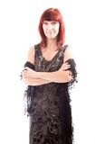 Mature woman standing with her arms crossed Royalty Free Stock Photos