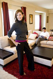 Mature woman standing in living room Stock Photography