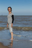 Mature woman standing in the sea Royalty Free Stock Photos