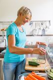 Woman in the kitchen preparing salad Royalty Free Stock Photo
