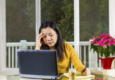 Mature woman stressed while working at Home Office Royalty Free Stock Images