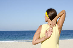 Mature woman stretch exercise beach Royalty Free Stock Photos