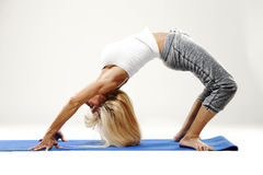 Mature woman stretching Stock Image