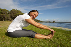 Mature woman Stretching Exercise Stock Photo