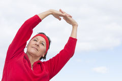 Mature woman stretching exercise outdoor Royalty Free Stock Photo