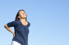 Mature woman suffering from back pain Stock Photography