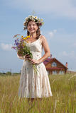 Mature woman  in summer field Stock Images
