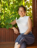 Mature woman  in summerhouse Stock Photography