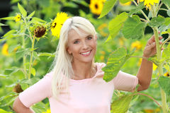 Mature woman with sunflowers Royalty Free Stock Photo
