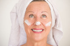 Mature Woman with sunscreen on face stock image