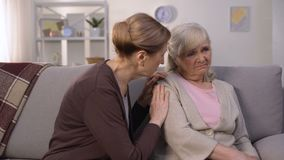 Mature woman supporting and comforting her elderly friend, health problems, loss. Stock footage stock footage