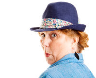 Mature Woman Surprised. Mature woman looking over her shoulder with a surprised expression.  Isolated on white Royalty Free Stock Image