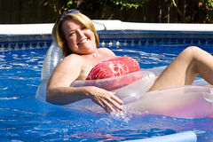 Mature woman at the swimming pool. Stock Images