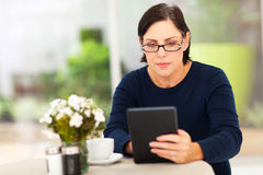 Mature woman tablet Stock Image