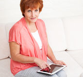 Mature woman with tablet pc Stock Images