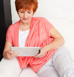 Mature woman with tablet pc Royalty Free Stock Image