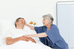Mature woman taking care of her husband Stock Photography