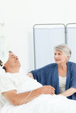 Mature woman taking care of her husband Royalty Free Stock Photo