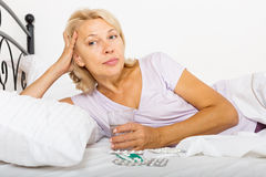 Mature woman  taking medicine Royalty Free Stock Photo