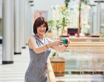 Mature woman taking photo by mobile camera Royalty Free Stock Images