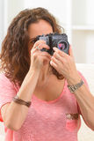 Mature woman taking pictures Stock Photos