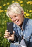 Mature woman taking selfie. Royalty Free Stock Photography