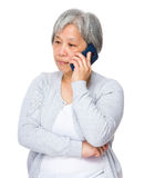 Mature woman talk to smart phone Royalty Free Stock Images