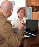 Mature woman talking with employee royalty free stock photo
