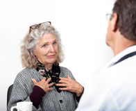 Mature Woman Talking Frankly with Her Doctor Stock Image