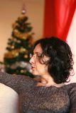 Mature woman talking with friends at Christmas Royalty Free Stock Photography