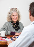 Mature Woman Talking with Her Doctor Stock Images