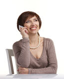 Mature woman talking on a mobile phone Royalty Free Stock Photo