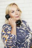 Mature woman talking on the phone royalty free stock image