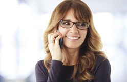 Mature woman talking on phone Royalty Free Stock Photo