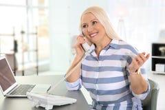 Mature woman talking on phone royalty free stock photo