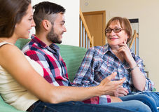 Mature woman talking with young people Stock Photography