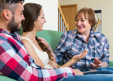 Mature woman talking with young people Stock Photo
