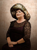 Mature woman in tapestry hat Stock Photos