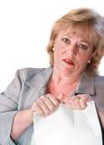 Mature woman tearing up paperwork Stock Image