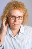Mature Woman on Telephone Headset Royalty Free Stock Photography