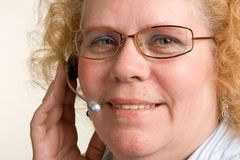 Mature Woman on Telephone Headset Royalty Free Stock Images