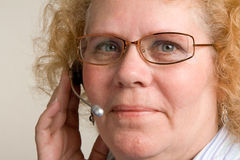 Mature Woman on Telephone Headset Royalty Free Stock Image