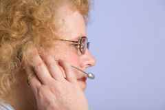 Mature Woman on Telephone Headset Stock Images