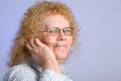 Mature Woman on Telephone Headset Royalty Free Stock Photos