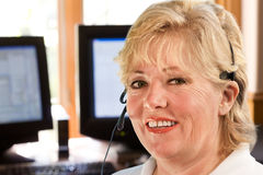 Mature woman with telephone headset Royalty Free Stock Images