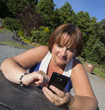 Mature woman texting on mobile Royalty Free Stock Photo