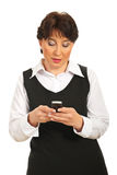 Mature woman texting sms Royalty Free Stock Photography