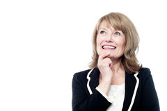 Mature woman thinking isolated on white Royalty Free Stock Images