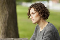Mature woman thinking at the park Royalty Free Stock Photos