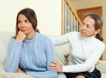 Mature woman tries asking apologies with teenage daughter Royalty Free Stock Photography